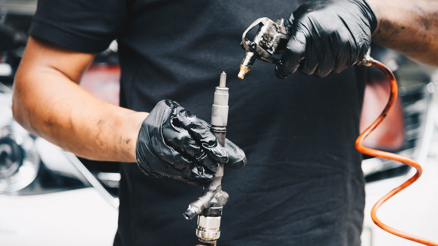 Close-up Day Drill Factory Focus On Foreground Fuel Pump Holding Human Body Part Human Hand Industry Machinery Manufacturing Equipment Men Occupation One Person Outdoors Protective Glove Real People Skill  Standing Technology Welder Work Tool Working Workshop