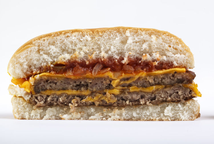 Close-up of burger against white background
