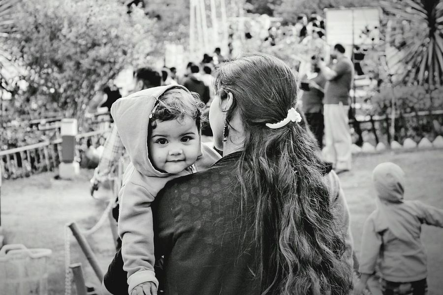 """""""Secured in my mom's arms"""" Shot this during my travel, Those eyes have a beautiful sparkle which let me to click this!!RePicture Motherhood Motherslove Mother&son Children's Portraits Babyboy Cute Baby Beautiful Eyes EyeEm Best Shots - Black + White Eye4photography  India"""