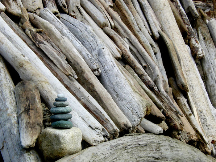 Stack of stones on driftwood