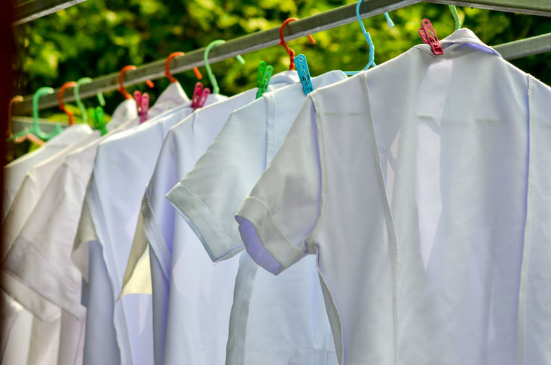 On vacation of a nurse Button Down Shirt Chores Clean Cleaning Clothesline Clothespin Clothing Day Drying Focus On Foreground Group Of Objects Hanging Housework In A Row Laundry Multi Colored No People Side By Side Textile Washing White Color