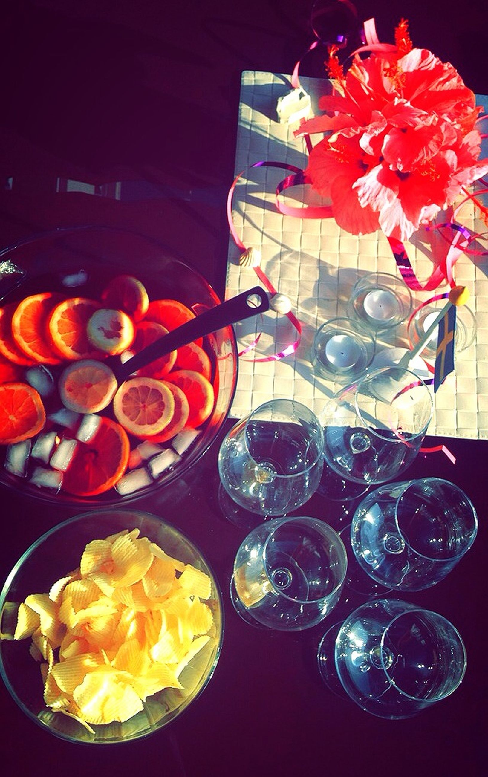 indoors, food and drink, freshness, table, food, still life, decoration, sweet food, flower, glass - material, multi colored, fruit, plate, variation, high angle view, indulgence, illuminated, ready-to-eat, no people, close-up