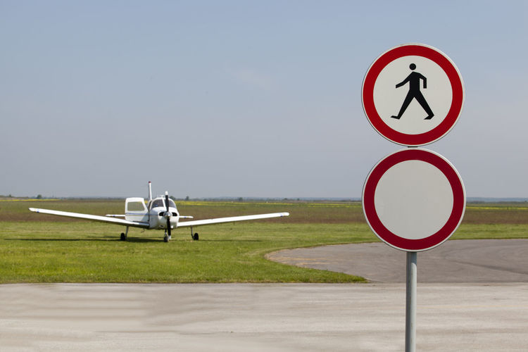 No pedestrians sign on an airfield runway. Aerodrome Aeroplane Access Aeroclub Air Vehicle Airfield Airplane Airport Airport Runway Dangerous Flying School Information Mode Of Transportation No Pedestrians No People Pedestrian Crossing Sign Pedestrian Sign Piloting Road Road Sign Sign Symbol Transportation Warning Warning Sign