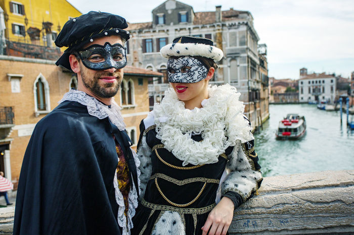 Carnival Carnivale In Venice Adult Adults Only Architecture Building Exterior Built Structure Carnival Costumes City City Life Close-up Day Fashion Looking At Camera Men Outdoors People Portrait Real People Standing Sunglasses Two People Warm Clothing Young Adult Young Women