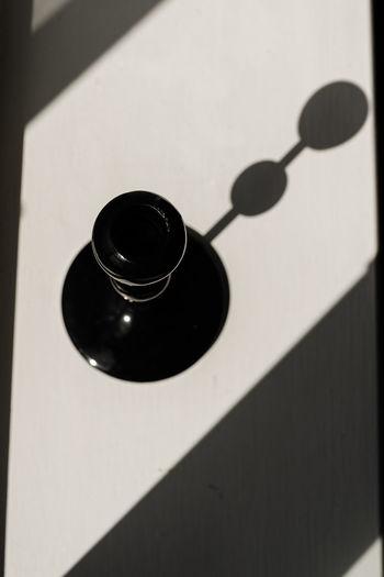 High angle view of black coffee on wall