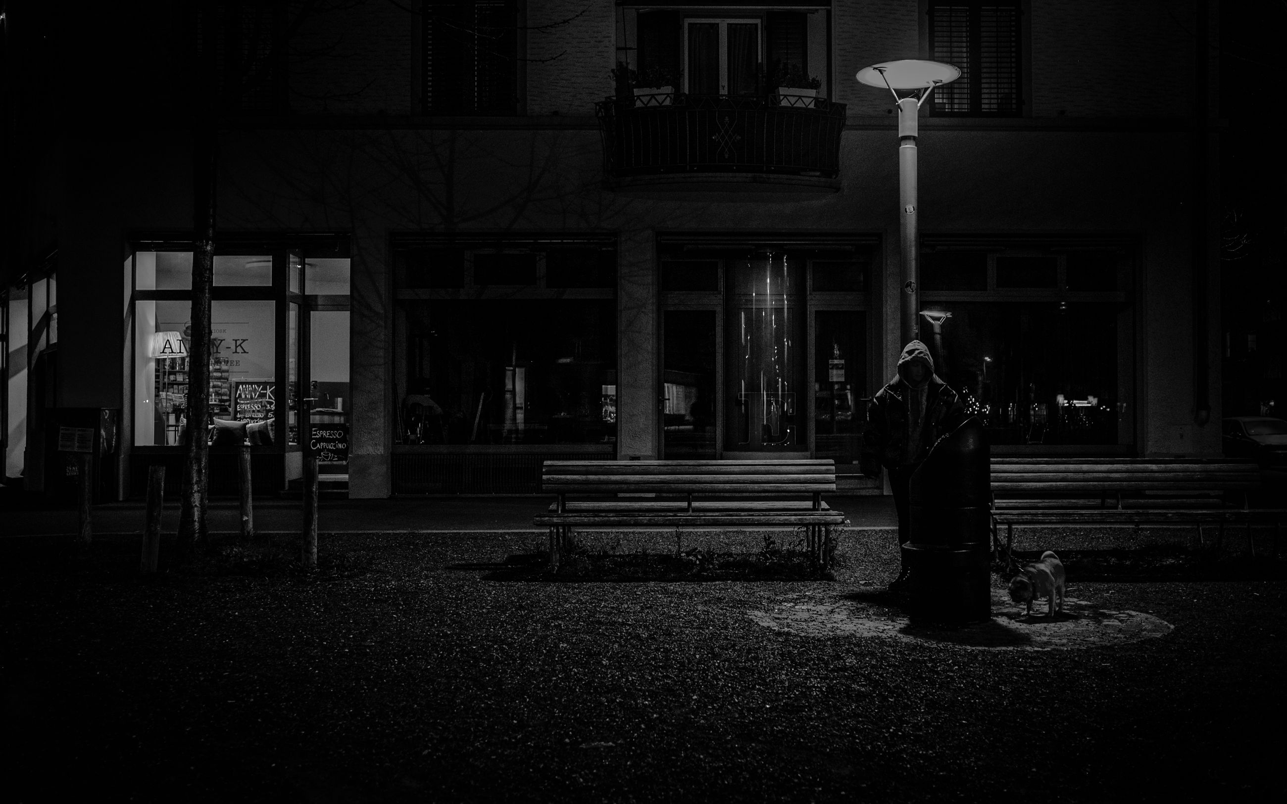darkness, night, black, light, lighting, architecture, black and white, monochrome, white, built structure, road, street, monochrome photography, building exterior, city, street light, one person, midnight, men, adult, full length, evening, outdoors