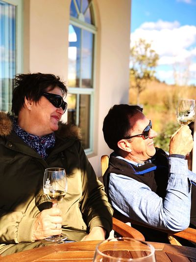 Through the looking glass. Champagne Sitting Real People Wineglass Drink Alcohol Glasses Glass Sunglasses Lifestyles Adult People Fashion