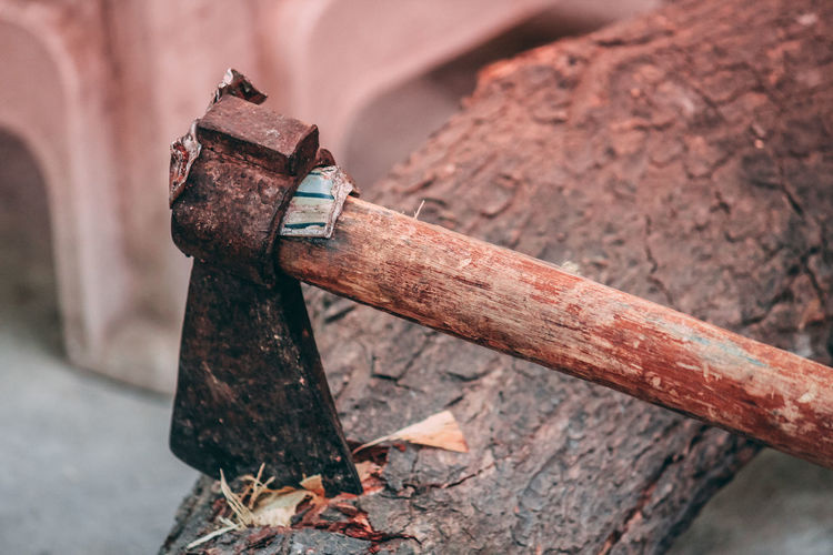 High angle view of axe on wood