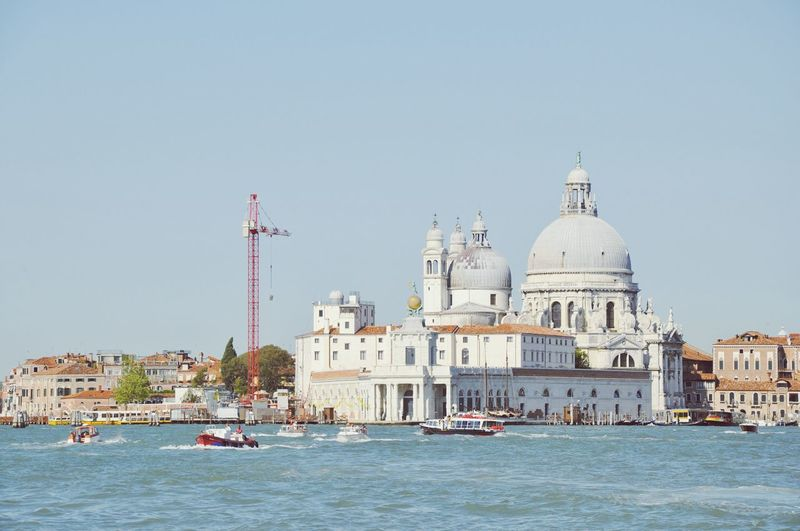Santa maria della salute by river against sky