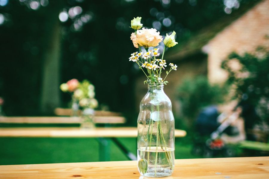 Empty table with a vase Flower Table Vase Focus On Foreground Freshness No People Wood - Material Close-up Nature Fragility Beauty In Nature Flower Head Wedding Photography Wedding Ceremony Decoration Wedding Decoration Table Setting Outdoors Outdoor Table Green Flowerporn Empty Places Vase Of Flowers Celebration Outdoor Event