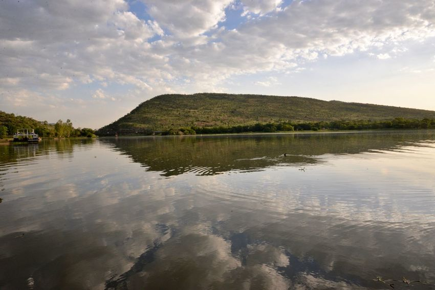 Hartbeespoort Hartbeespoort Dam Harties Day Hartbeespoort Dam Wall Mountain Hartebeespoort Beauty In Nature Outdoors No People Cloud - Sky Waterfront Tranquility Tranquil Scene Scenics Nature Lake Sky Water Sunlight Idyllic Reflection Tranquility Nature Beauty In Nature Tree Landscape