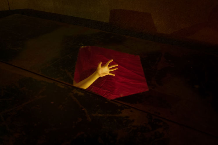 High angle view of red paper on wall at night