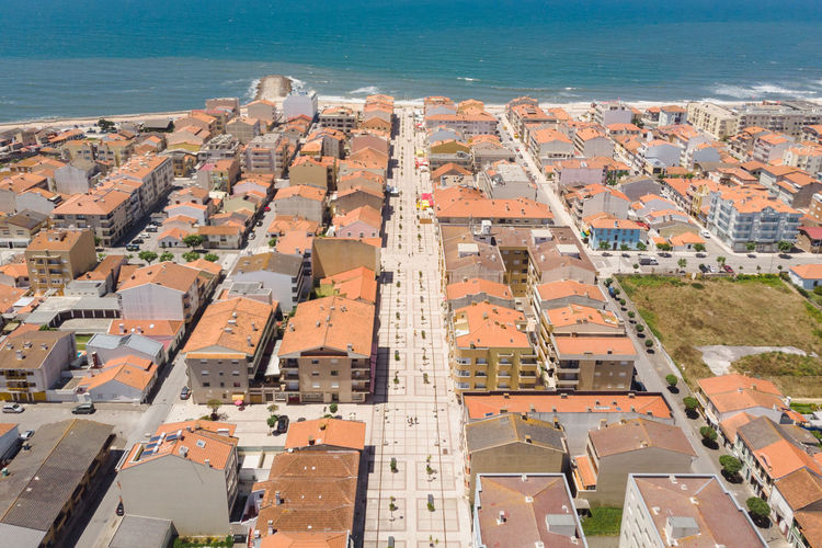 Aerial view of Furadouro, Portugal and the atlantic ocean Atlantic Ocean Porto Portugal Portuguese Streets Aerial View Architecture City Cityscape Furadouro Furadouro, Ovar High Angle View House Nature No People Outdoors Ovar Residential District Sunlight Town