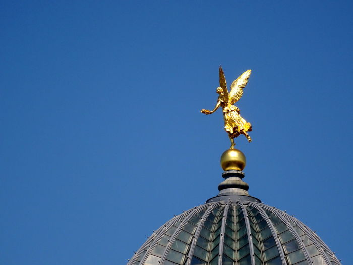Statue On Domed Structure Against Clear Blue Sky