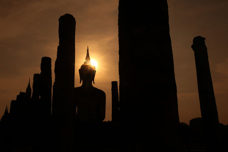 Silhouette Of A Statue Of Buddha In Wat Mahathat Temple