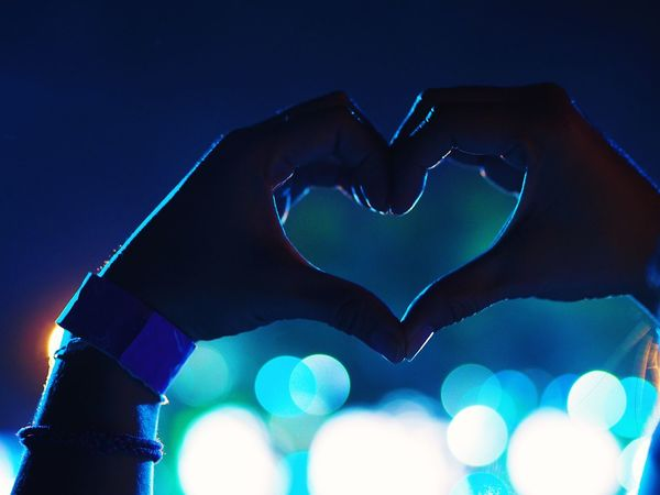 Girl making a heart-shape symbol in concert. Hands Blue Close-up Concert Heart Heart Shape Human Body Part Human Hand Illuminated Love Night One Person Outdoors People Shape Of Heart Sign Of Love Symbol