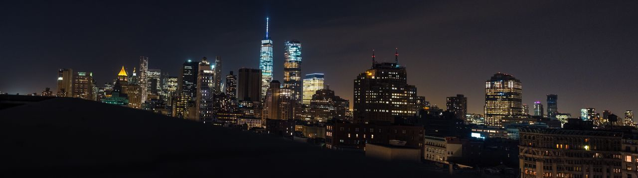 View of skyscrapers lit up at night