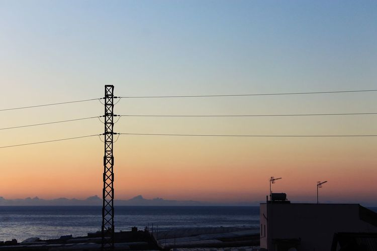 Orange Sky Beauty In Nature Blue Blue Sky Cable Canon Canon1100d Canonphotography Connection Electricity  Electricity Pylon Nature Orange Color Outdoors Photography Power Line  Power Supply Scenics - Nature Sea Silhouette Sky Sunset Technology Tranquil Scene Water