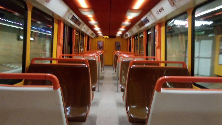 Alone... Orange Loneliness Colors Of The Night Night And Light In A Row Illuminated Rail Transportation Mode Of Transport Commuter Train Chair No People Seat Travel Train Interior