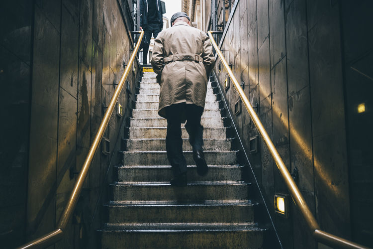 the way up Light Rainy Days Architecture Built Structure Casual Clothing Direction Footpath Full Length Lifestyles Men Motion Moving Up on the move One Person Outdoors Railing Real People Rear View Refection Staircase Steps And Staircases The Way Forward Walking Warm Clothing