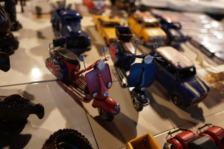 High Angle View Of Toy Motor Scooters On Table