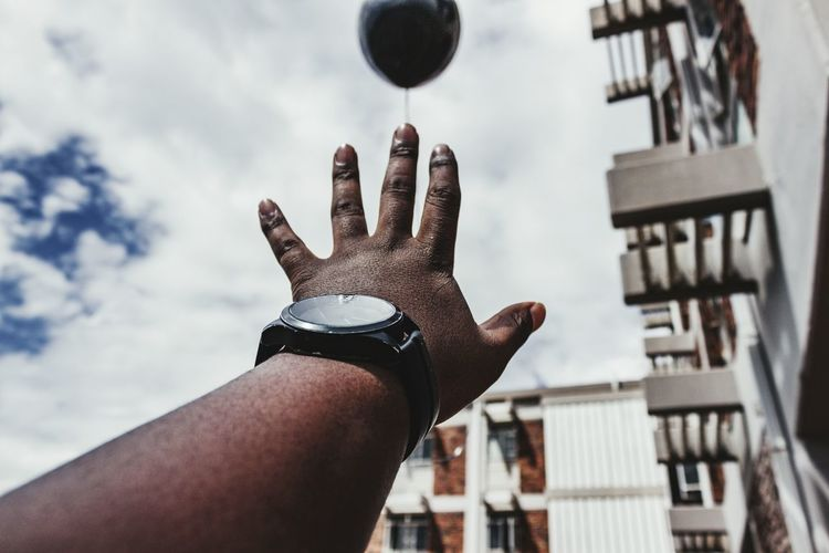Some things fly away Balloon Canonphotography Canon T3i 600D EyeEm Selects Human Hand City Sky Close-up Building Exterior Architecture Cloud - Sky Personal Perspective Wrist Hand Human Joint Body Part Finger