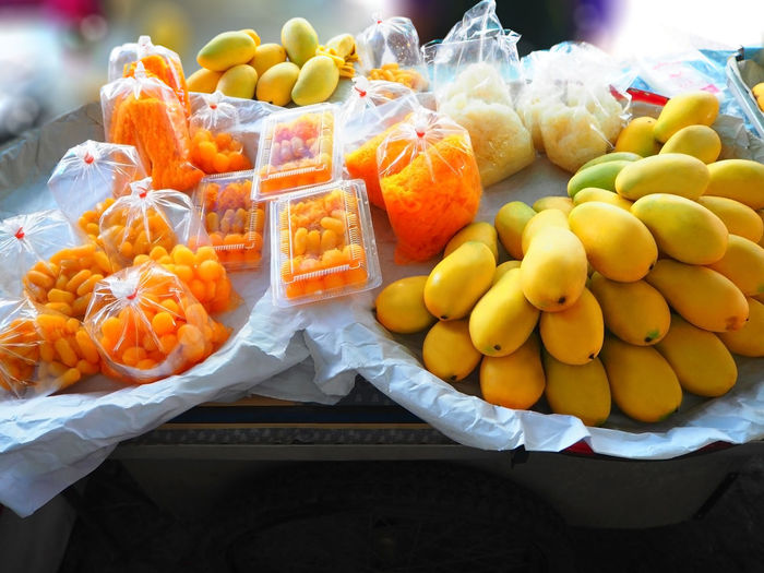 💛 43 Golden Moments 💛 Arrangement Choice Close-up Dessert Display Exceptional Photographs Food For Sale Freshness Colour Of Life Healthy Eating Large Group Of Objects Mango Market Market Stall Retail  Ripe Sale Still Life Store Street Photography Sweets Tadaa Community Travel Food Stories