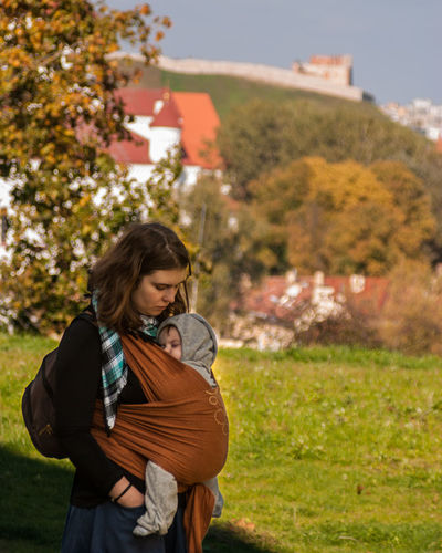 The Old City of Vilnius is near Autumn Baby Baby Sling Baby Wrap Babywearing Bonding Childhood Children Day Family Leisure Activity Lifestyle Love Maternity Mom Mother And Son Motherhood Outdoors Parenting Selective Focus Sling Standing Vilnius Waist Up Woman Neighborhood Map