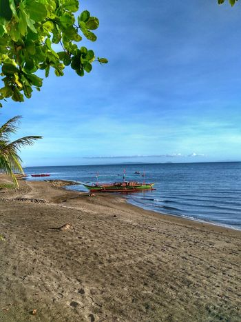 Sea Beach Blue Sand Sky Beauty In Nature Tranquility Nature Horizon Over Water Scenics Tree Tranquil Scene Water Outdoors No People Vacations Day Postcard Eyeem Philippines Vacations Bicol, Philippines Travelphotography