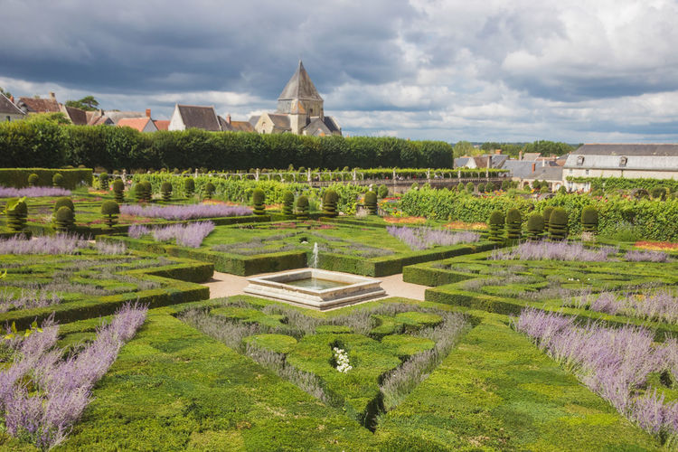 High angle view of formal garden against sky