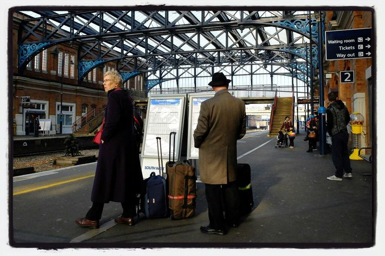 Elderly couple on their way to their holidays. Starting A Trip Bournemouth Commuting