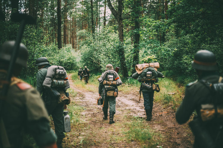 Group Of Unidentified Re-enactors Dressed As German Soldiers Marching Along Forest Road. Summer Season. War Forest Gun Weapon Ww2 WWII Ww1 Army Soviet Ussr Re-enactors German History Millitary Histirical Wehrmacht Russian Marching Tree Road The Photojournalist - 2019 EyeEm Awards