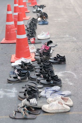 High angle view of shoes on road