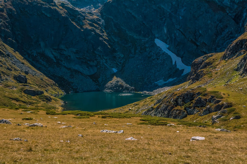 Seven Rila Lakes, Bulgaria - Rila mountain; The Trefoil Трилистника (Trilistnika) 2,216 m (7,270 ft) 2.6 ha (6.4 acres) 6.5 m (21 ft) Irregular shape and low shores Nature Photography Mountain Beauty In Nature Water Scenics - Nature Tranquility Tranquil Scene Lake Nature Non-urban Scene Mountain Range No People Day Environment Landscape Land Remote Rock Idyllic Plant Outdoors Formation Snow Lake View Beauty In Nature Nature Lakeside Horizon Over Water Rock Formation Snow Covered