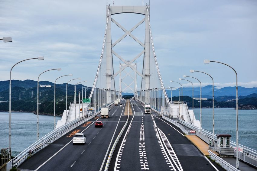 Architecture Bridge - Man Made Structure Cable City Cloud - Sky Connection Day Highway No People Outdoors Sea Sky Suspension Bridge Transportation
