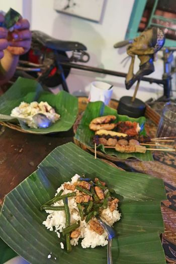 Banana Leaf Meals Sego Kucing Banana Leaf Banana Leaf Plate Banana Leaf Wrap Business Close-up Food Food And Drink Freshness Hand Healthy Eating Human Hand Indoors  Leaf Leaves Meal Meat One Person Plate Ready-to-eat Sego Kucing Serving Size Table Wellbeing