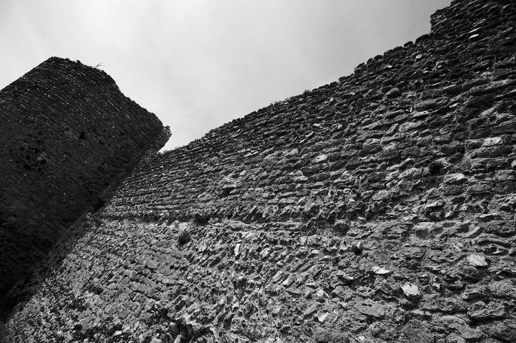 Climbing The Wall Castle Architecture Blackandwhite Built Structure Castle Ruin Day Low Angle View Outdoors Rough Sky Stone Wall Textured  Tranquility Wall Wall - Building Feature