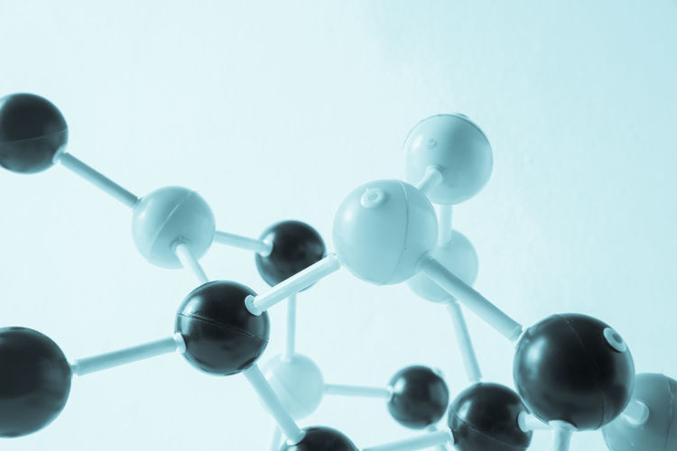 Close-up of atoms against white background