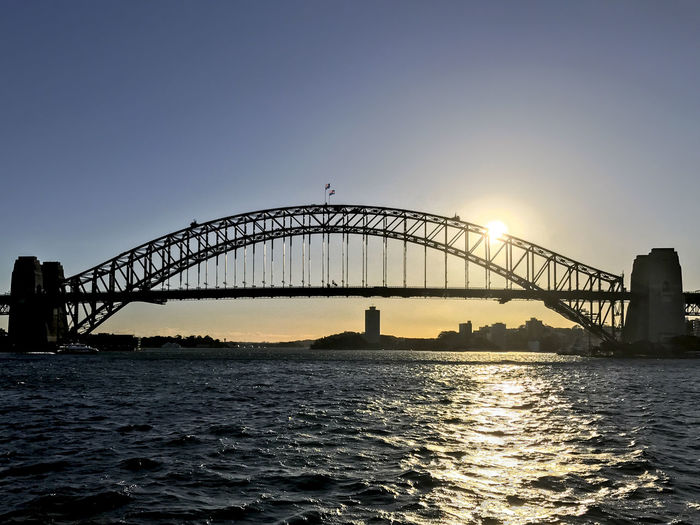 Sydney Harbour Bridge. EyeEm Selects Arch Arch Bridge Architecture Bridge Bridge - Man Made Structure Building Exterior Built Structure City Clear Sky Connection Nature No People Outdoors Silhouette Sky Sunset Transportation Travel Water Waterfront