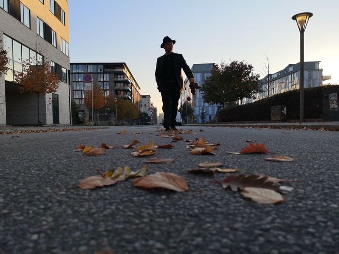 Man standing on street during autumn