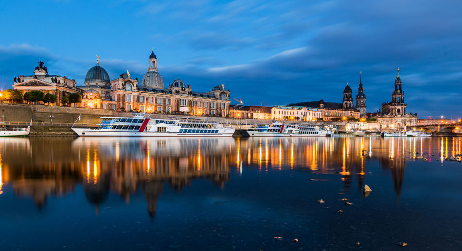 Boats Moored On River By Dresden Frauenkirche At Dusk