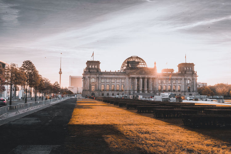 Architecture Building Building Exterior Built Structure City Direction Dome Government History Incidental People Nature Outdoors Reichstag Sky Sunlight Sunset The Way Forward Tourism Transportation Travel Travel Destinations Water