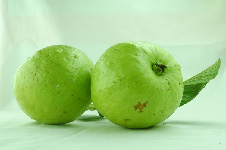 Guava fruit on a white background Guava  Guava Fruit Fruit Healthy Lifestyle Water Granny Smith Apple Social Issues Ripe Drop Close-up Green Color Food And Drink Vitamin Juicy Vitamin C