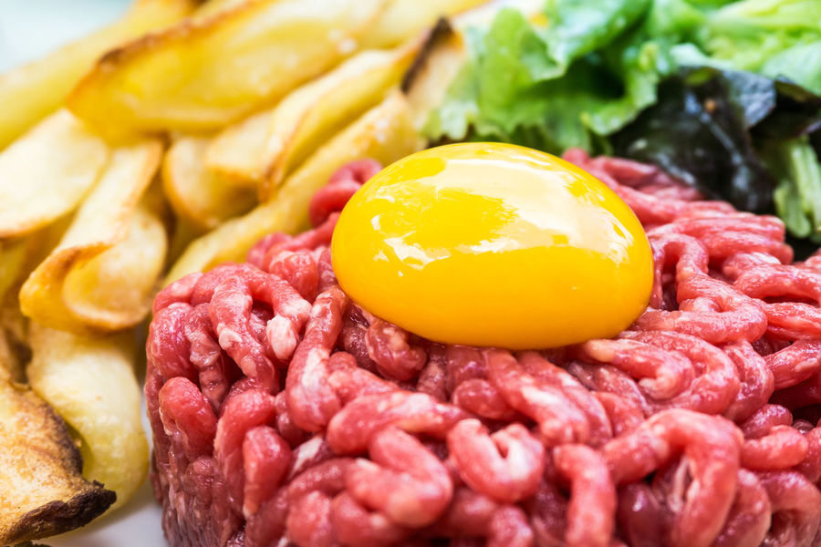Close-up Day Egg Egg Yolk Food Food And Drink Freshness Indoors  No People Plate Raw Beef Raw Food Ready-to-eat