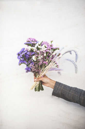 Flowering Plant Flower Flower Arrangement One Person Plant Bouquet Holding Hand Nature Human Hand Human Body Part Real People Fragility Vulnerability  Indoors  Beauty In Nature Freshness Women Adult Bunch Of Flowers Flower Head Purple The Minimalist - 2019 EyeEm Awards