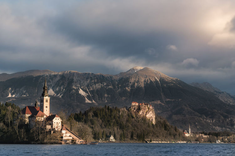 Church by sea against mountain