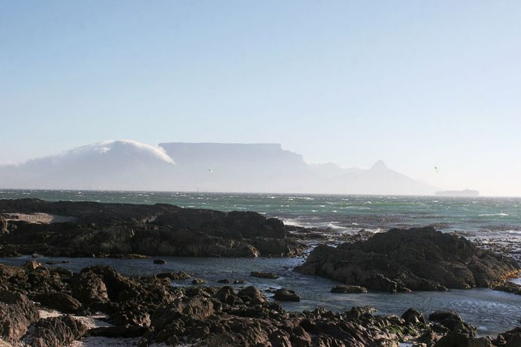 Table Mountain Beach Beauty In Nature Day False Bay Land Mountain No People Non-urban Scene Outdoors Rock Rock - Object Rocky Coastline Scenics - Nature Sea Sky Solid Tranquil Scene Tranquility Water