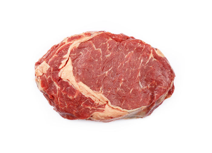 Close up raw beef rib eye steak isolated on white, elevated top view, directly above Isolated Raw Meat   Red Beef Close-up Cut Out Food Food And Drink Freshness Healthy Eating Meat No People One Raw Food Rib Eye Steak Ribeye Ribeye Steak Steak Studio Shot Unhealthy Eating White Background