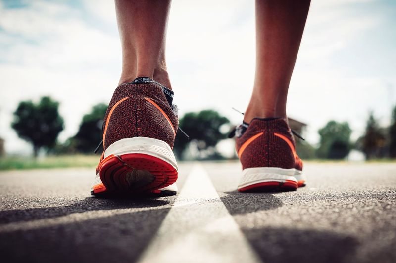 Running Human Leg Human Body Part Low Section Athlete One Woman Only Adults Only One Person Sport Shoes Sports Sport Shoes Starting Line People Only Women Road Adult Outdoors Day Track And Field Athlete