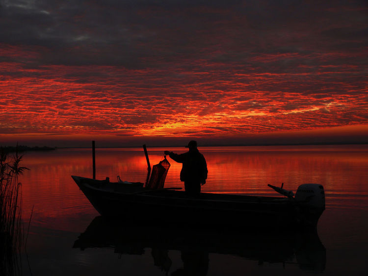 People And Places Enjoying The Sun Sea And Sky Italy Beautiful Sunset Nature Fischerman No Filter Sky And Clouds Water Reflections Scardovari
